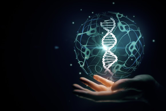 DNA helix image over outstretched palm