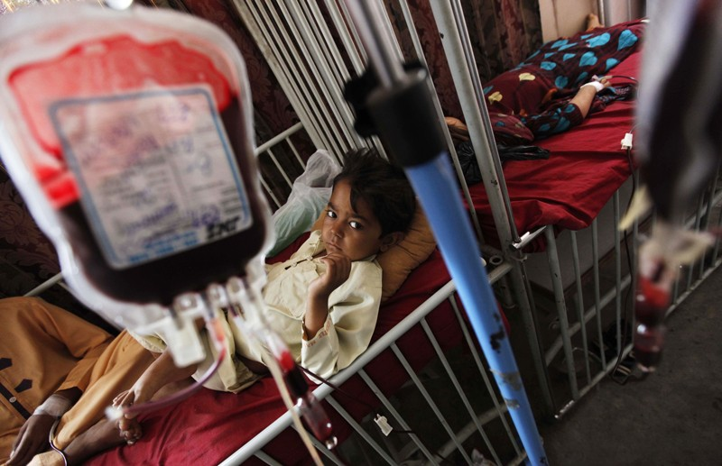 A young Pakistani suffering from the blood disorder Thalassemia receives a blood transfusion